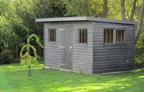 An attractive garden shed in stained with a grey preservative and featuring a pent roof covered with heavy duty felt. The windows have stainless steel security bars on them.