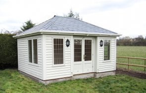 3.6 x 4.8m Hipped Roof Garden Room in the colour Sandstone from our exterior paint system