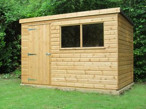 A pent-roofed garden shed with a single access door and two fixed windows in the front. The building is clad with smooth shiplap and painted in a light oak preservative which allows the natural beauty of the wood to show through.