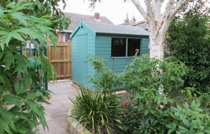A small and bright-coloured classic shed with an apex roof covered in heavy-duty felt and smooth shiplap cladding painted in Mint