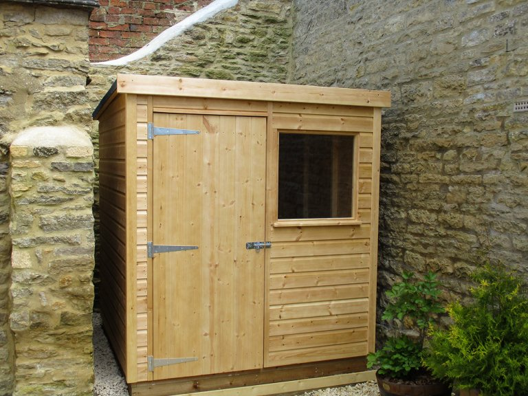 1.8m x 3.0m Classic Shed made with shiplap timber cladding treated with a Light Oak Preservative