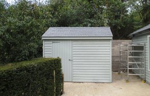 Superior Shed with Matching Garden Room in Verdigris Paint with an Apex roof covered in Grey Slate Tiles
