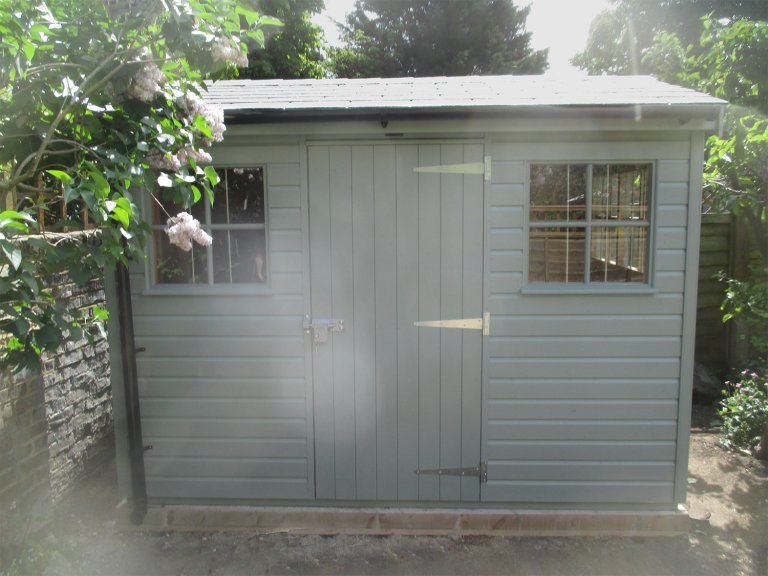 Superior Shed in Sage Green paint with Georgian Windows and an apex slate roof