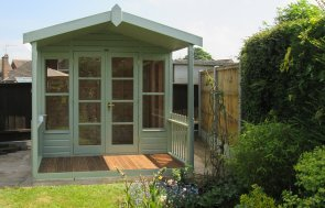 Morston Summerhouse that has a veranda and roof overhang with double doors and an apex felt roof in Lizard Paint