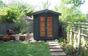 Blakeney Summerhouse with Shed Storage Section painted in Farrow and Ball's Studio Green
