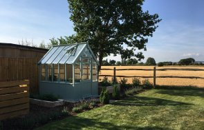 1.8 x 2.4m Greenhouse with Shiplap Cladding coated in Sage Paint