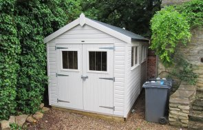 An appealing garden shed that has double access doors and an apex roof. It has smooth shiplap cladding painted in Twine and several windows with a security pack.