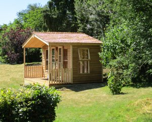 A wooden, chalet-style summerhouse with rustic weatherboard cladding and a small veranda.