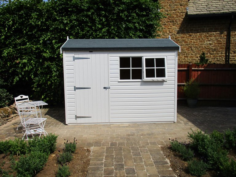 An attractive apex shed with single door access and two georgian windows, one that opens