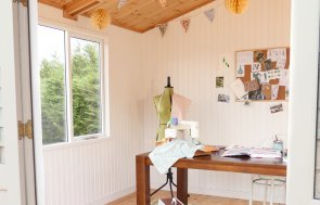 Binham Studio Interior dressed as a crafts room with a mannequin, sewing machine, moodboard and bunting