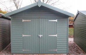 A medium sized superior shed that has shiplap cladding painted in the shade of farrow and ball green smoke. The building has an apex roof covered in heavy duty felt  and several windows down one side.