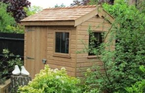 An image of a medium sized superior shed with one of the double access doors open so that the interior is visible. The interior is natural wood with an apex roof.