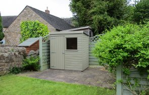 1.2m x 1.8m shiplap clad garden shed from our Classic Shed range, painted in Stone with a pent roof
