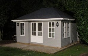 Garden Room in the colour Pebble with Georgian windows and a hipped roof covered in our grey slate effect tiles