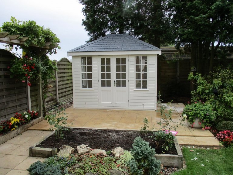 2.4 x 3.0m Cley Summerhouse with Georgian Windows and a Hipped Roof covered in Grey Slate Effect Tiles