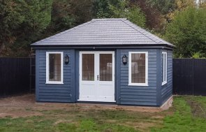 Garden Room painted all over in the colour Slate with Ivory doors and windows