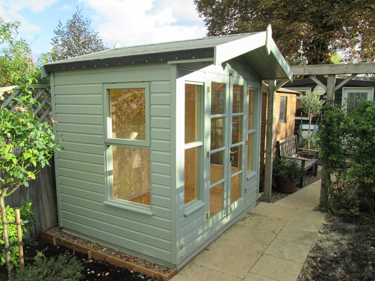 2.4 x 1.8m Blakeney Summerhouse with Shiplap Cladding coated in Lizard paint