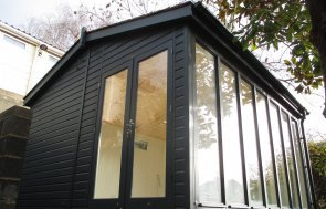 Slate-Painted Burnham Studio with Painted Matchboard Lining and an Electric Pack with Heater