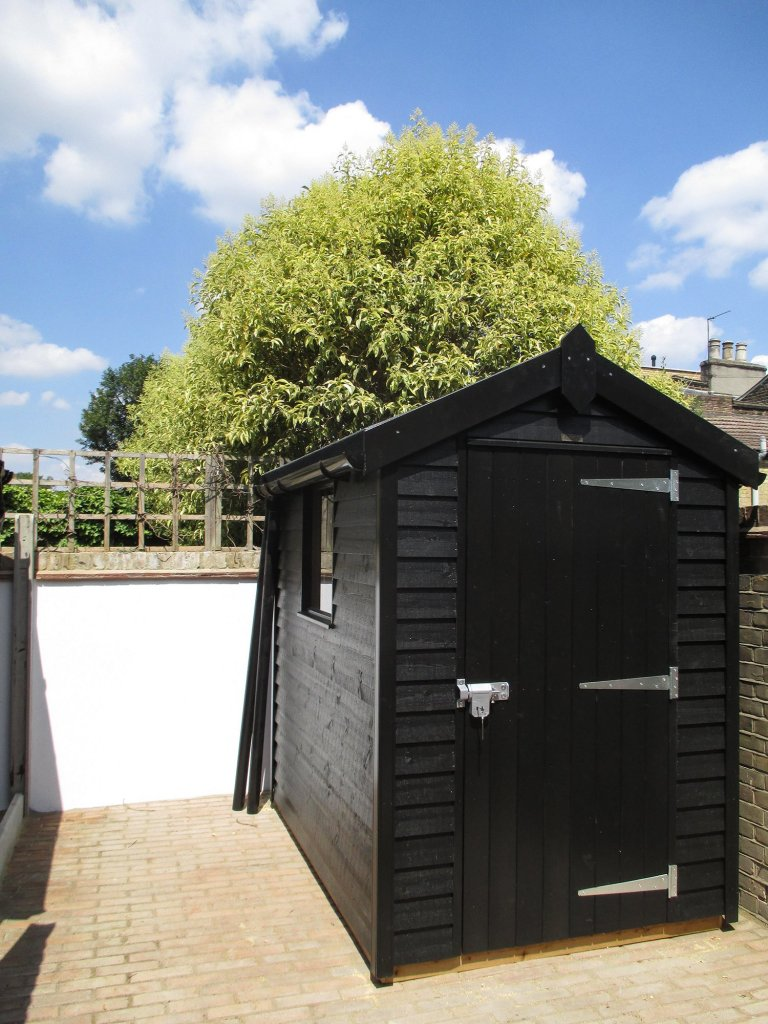 A Black Sikkens Stained 1.5 x 2.1m Superior Shed with Apex Roof and Weatherboard Cladding