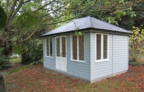 Attractive Cley Summerhouse painted externally in two-tone paint with a slate covered hipped roof and leaded windows. The summerhouse boasts internal insulation and lining as well as electrics.