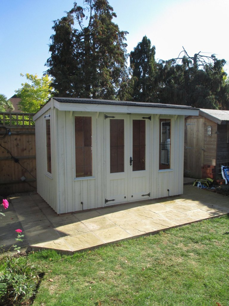 A charming Flatford summerhouse from our national trust range of sheds and summerhouse. The timber building has a pent roof covered with corrugated material