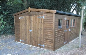 Large timber garage with shiplap cladding coated in the Walnut preservative stain. The high quality