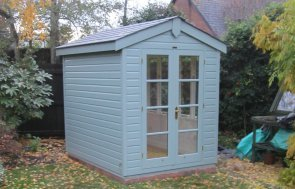 A holkham summerhouse with apex roof covered in grey slate composite tiles. The summerhouse is clad with smooth shiplap cladding and boasts double doors and windows. The timber garden building is contemporary and would make the ideal work-from-home office.