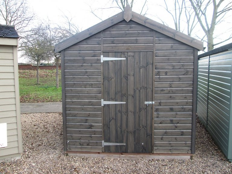Attractive display building at our Nottingham showsite. A large timber garden shed clad with smooth shiplap and painted in the preservative stain of sikkens grey.