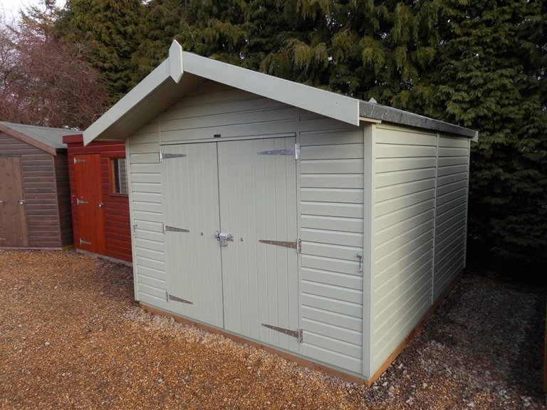 3.0 x 3.6m Superior Shed painted in Lizard with Overhanging Apex Roof and Double Doors
