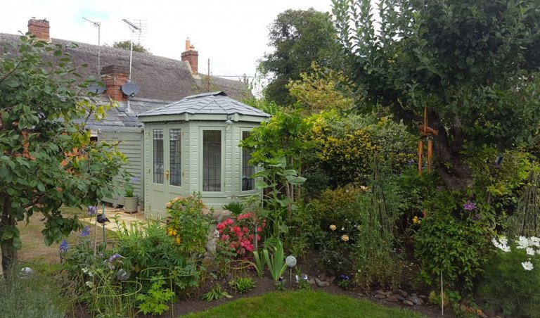 Traditional Wooden Summerhouse with Slate Roof