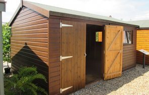 3.0 x 4.8m Superior Shed in Sikkens Walnut paint located at Brighton Show Centre as a ex display building