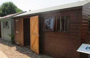 Superior Shed painted in Walnut Sikkens stain situated at Crane's Brighton Show Centre