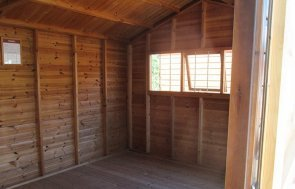 Unlined interior of a 3.0 x 4.8m Superior Shed with a security pack at Brighton Show Centre