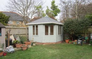3.0 x 3.0m Weybourne Corner Summerhouse painted in Verdigris with Grey Slate Effect Tiles and Guttering