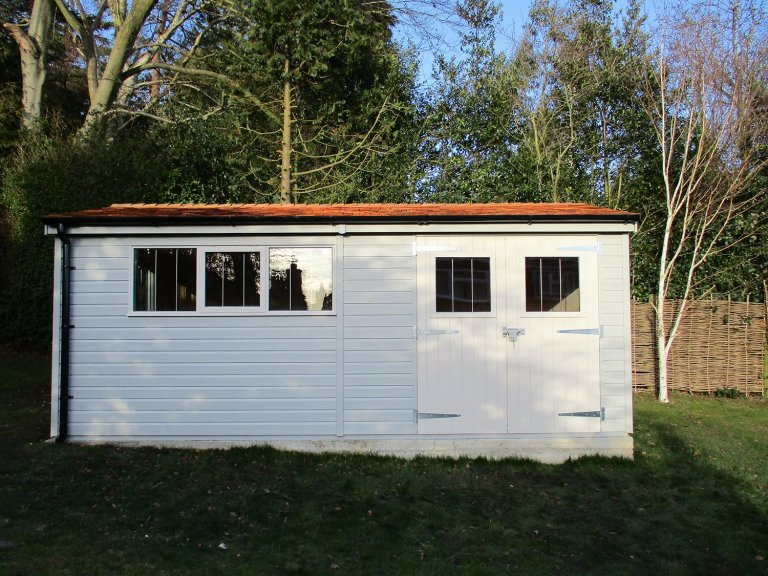 A pebble painted 3.0 x 5.4m Superior Shed with electric and security packs