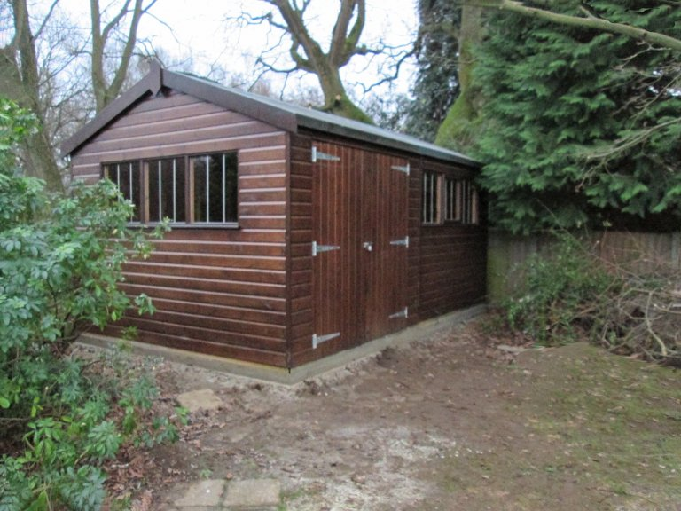 3.0 x 4.8m Walnut colour Superior Shed with a security pack and an apex roof covered in our heavy duty roofing felt