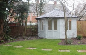 Weybourne Timber Corner Summerhouse with Double Doors and Shiplap Cladding painted in Verdigris
