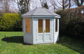 Small 2.4 x 3.0m Timber Octagonal Summerhouse with Leaded Windows and Shiplap Cladding painted in Verdigris