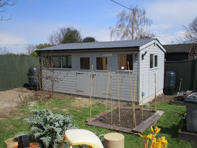 Attractive Garden Shed with Slate Roof