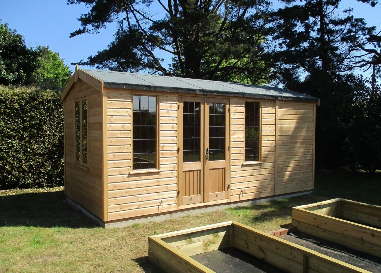 2.4 x 4.8m Light Oak Holkham Summerhouse with Apex Roof covered in Heavy Duty Roofing Felt