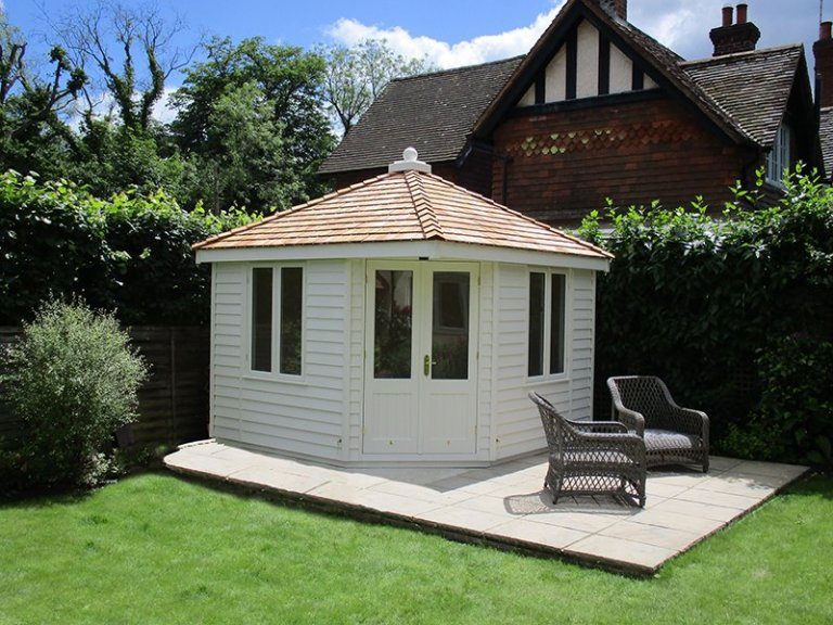 Weybourne Summerhouse in Exterior Paint System Cream with weatherboard cladding and a hipped roof with cedar shingle tiles
