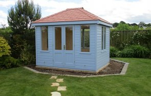 Cley Summerhouse in Valtti Sundrenched Blue with a hipped roof covered in our terracotta slate effect tiles