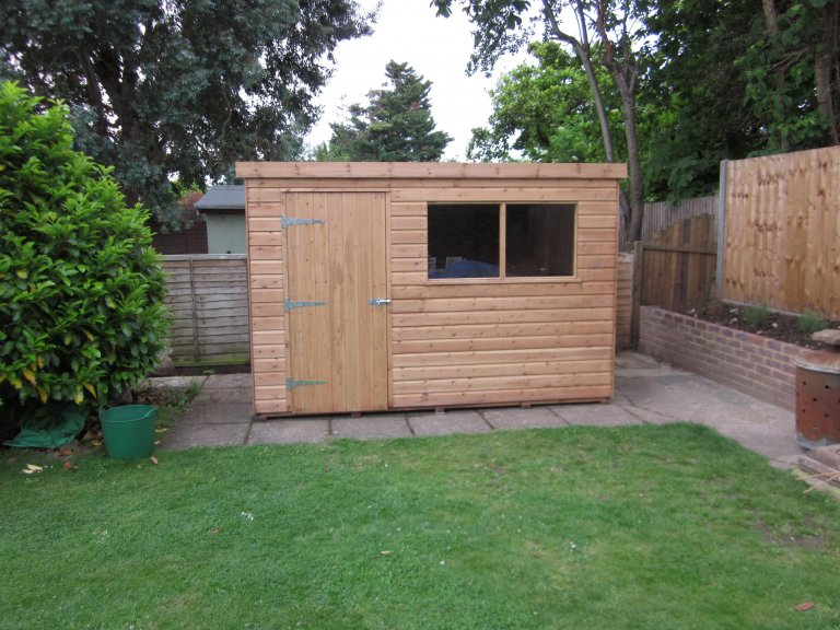 Superior Shed with Light Oak Perservative and Pent Roof