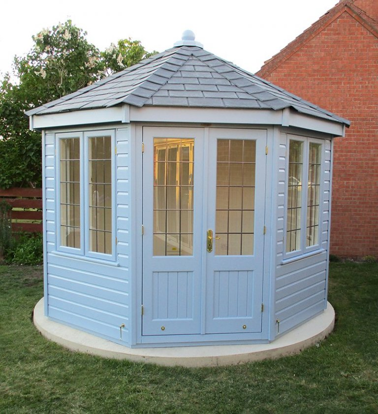 Wiveton Summerhouse in Sundrenched Blue with grey slate effect titles and smooth shiplap cladding