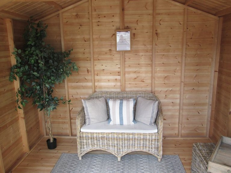 3.0 x 3.6m Morston Summerhouse at our Nottingham Show Site with chair and plant