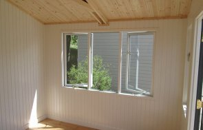 3.6 x 3.0m Binham Studio at our Nottingham Show Site Internal with opening windows and Ivory painted matchboard lining