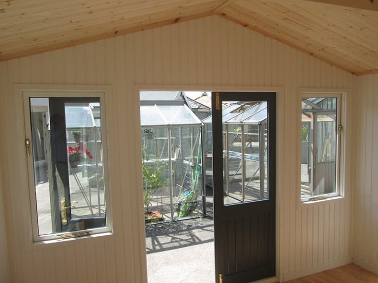 3.0 x 3.6m Morston Summerhouse at our Nottingham Show Site with Ivory painted matchboard lining and opening windows