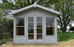 Pretty Blakeney Summerhouse in Farrow & Ball Manor House Gray with storage partition