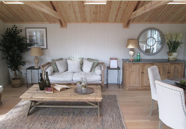 6.0 x 6.0m Pavilion Garden Room at our Nottingham Show Site - Interior with sofa and dining table