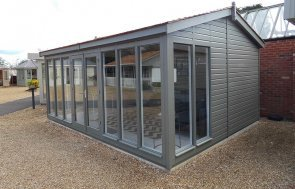 4.2 x 5.4m Burnham Studio at our Burford Show Site with cedar shingle tiles in the shade Ash from our exterior paint system